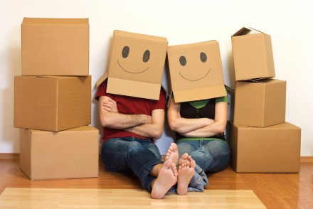 couple with smiley face moving boxes
