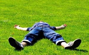 guy passed out on a patch of grass