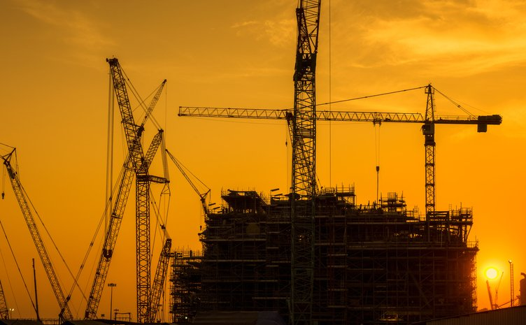 Silhouette of construction activities.