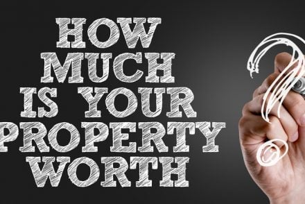 """Words """"How Much is Your Property Worth? """" on a blackboard"""