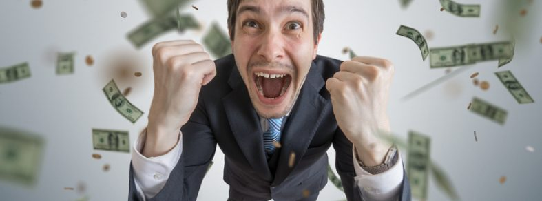 money falling onto young businessman