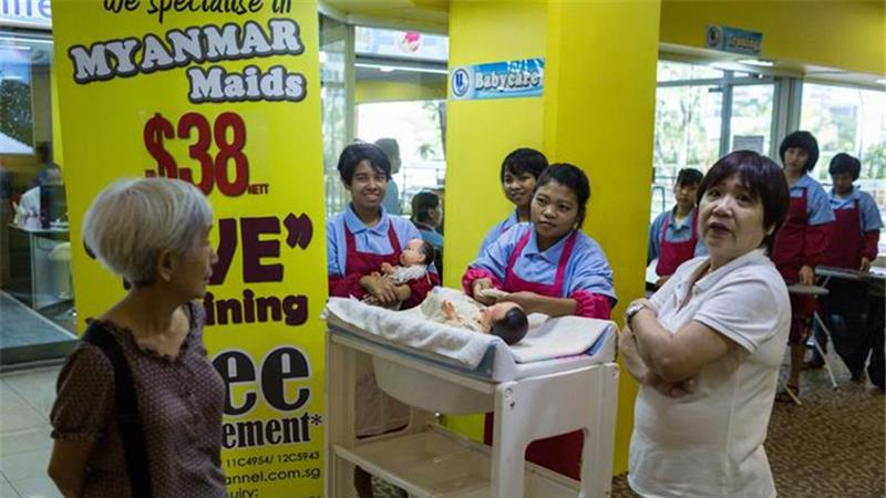 Domestic helpers at a showroom