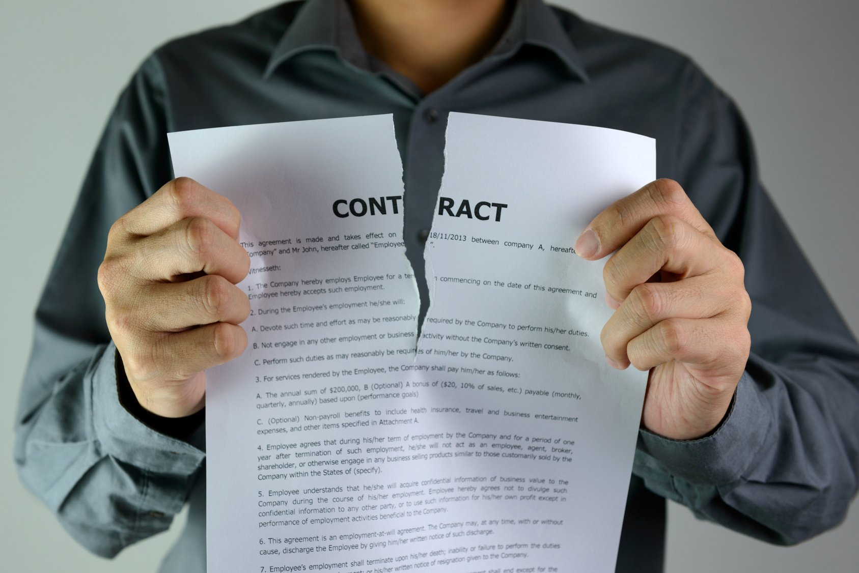 Person tearing a tenancy agreement.