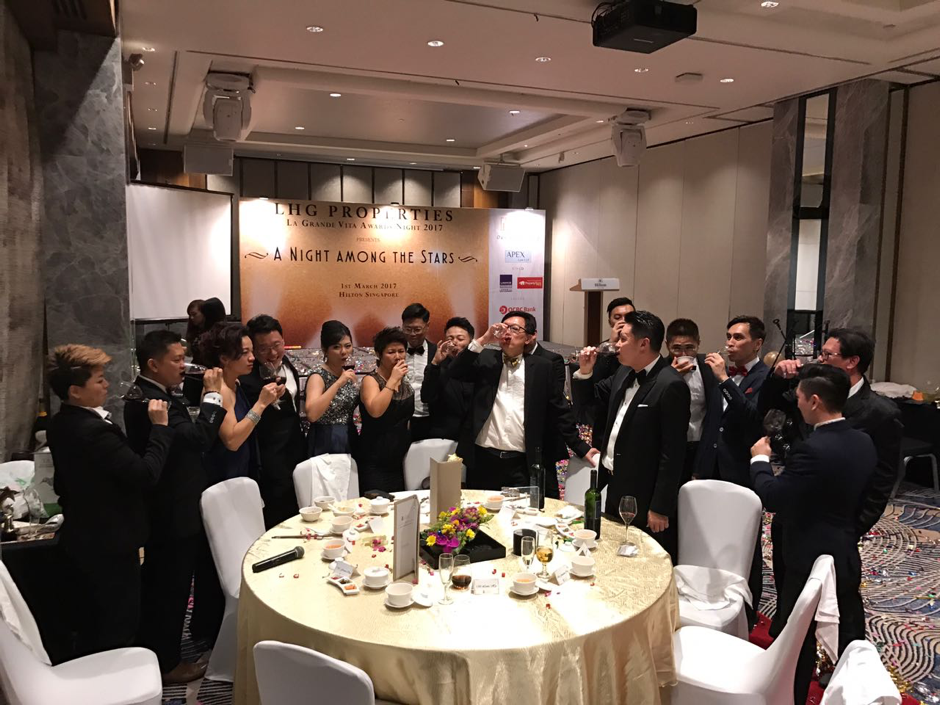 Lewis and property agents in celebratory mode at a LHG banquet earlier this year
