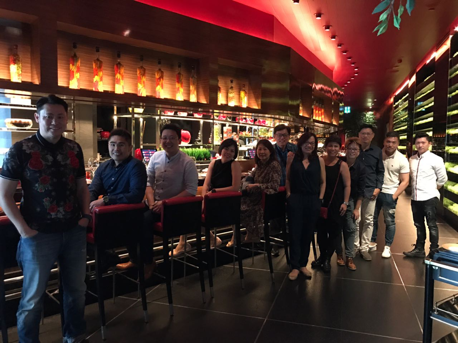 Lewis and his team leaders dining at a Michelin-starred restaurant in Bangkok