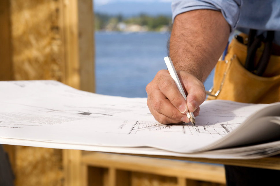 Contractor making notes