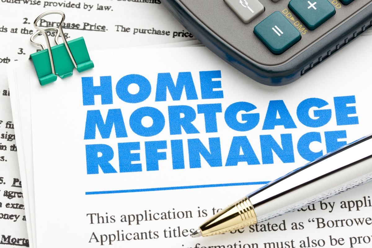 Documents relating to Home Mortgage Refinance, along with a pen and calculator