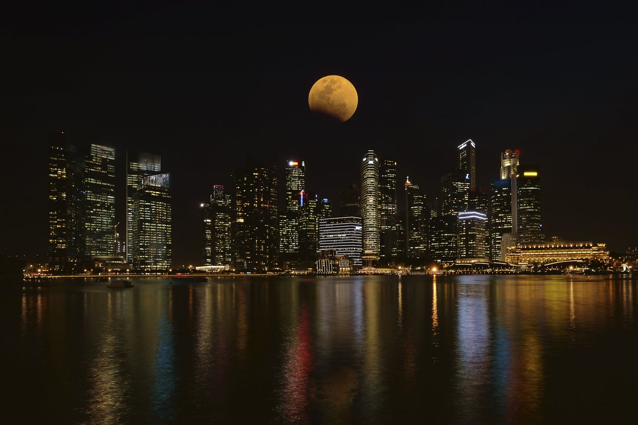 Full moon over Singapore City during lunar month