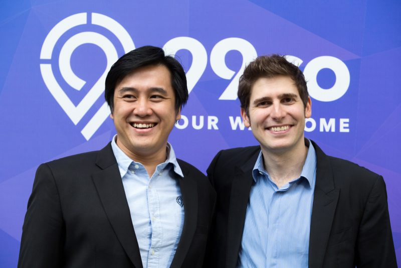 (From left) Darius Cheung of 99.co and Eduardo Saverin