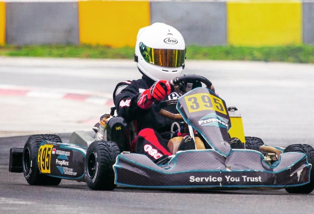 norman koh propnex car racing