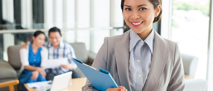 Female real estate agent holding a file