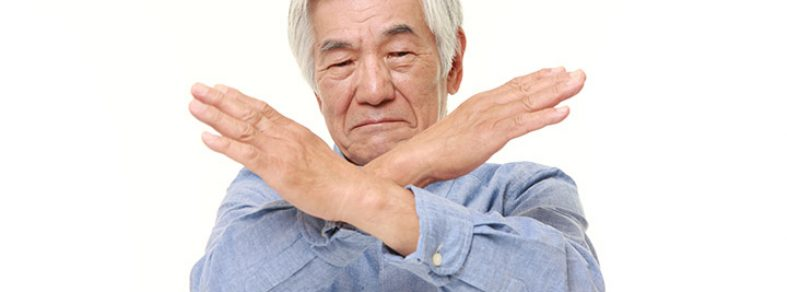 Old man crossing his arms in an X