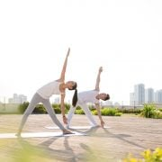 couple yoga pose outdoors