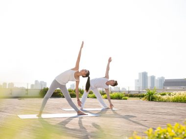 couple yoga pose outdoors