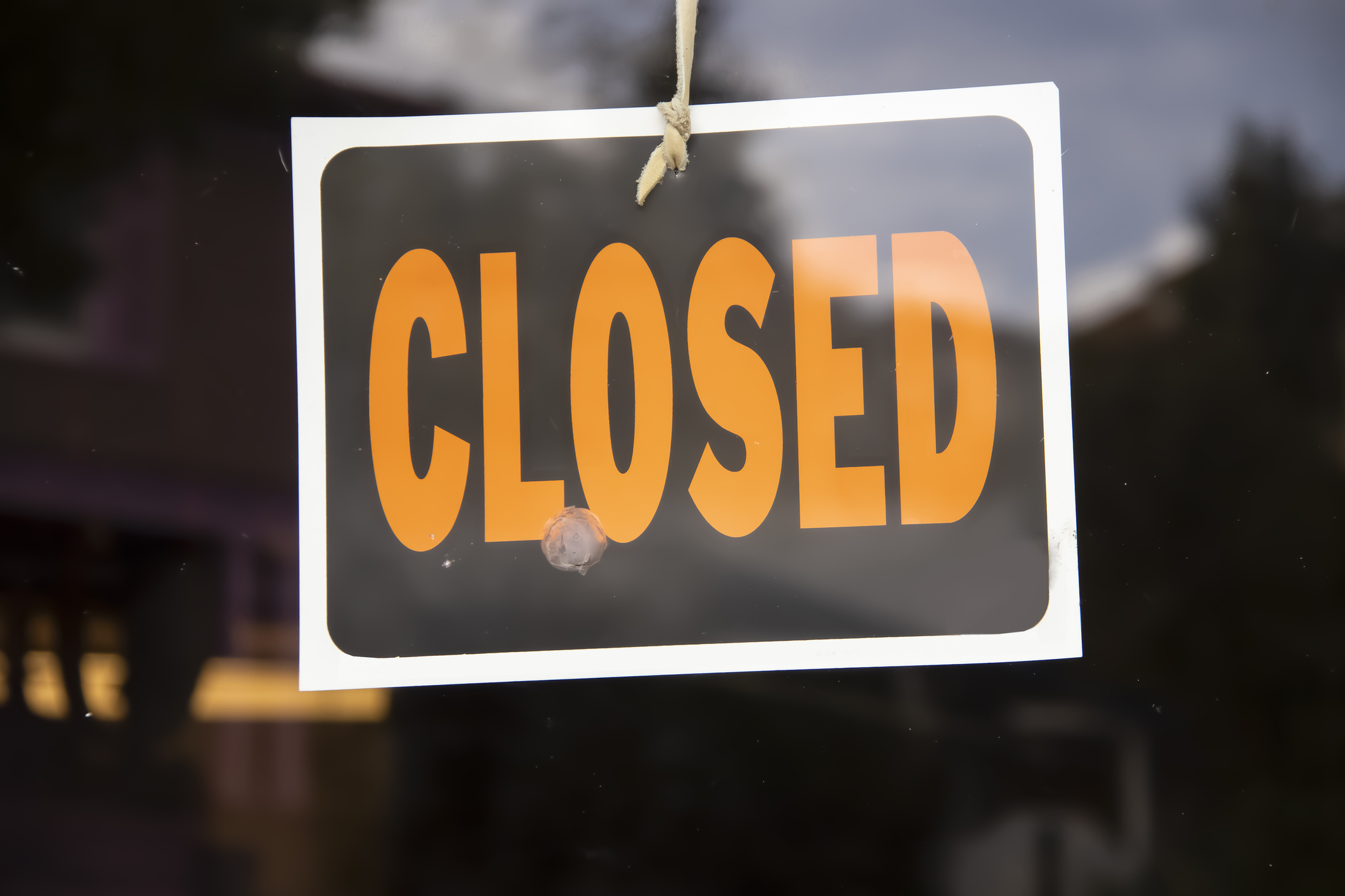 Closed sign hanging on a door