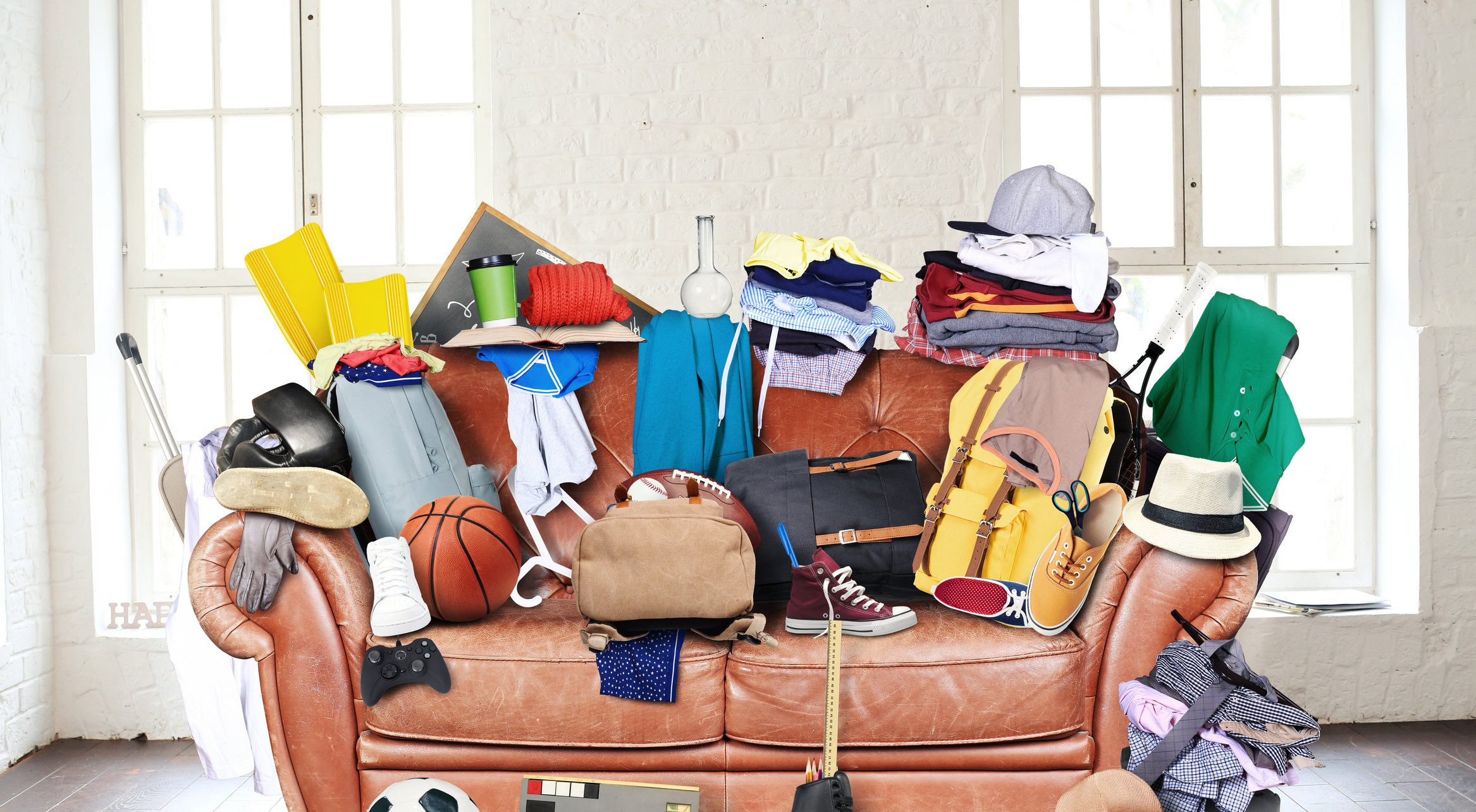 Couch cluttered with household objects