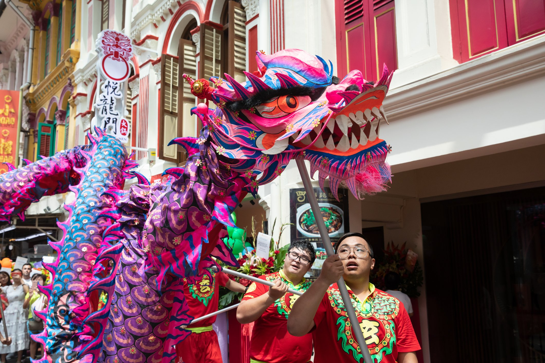 Dragon dance outside shophouse in Chinatown
