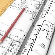 Set of floor plans and a pencil