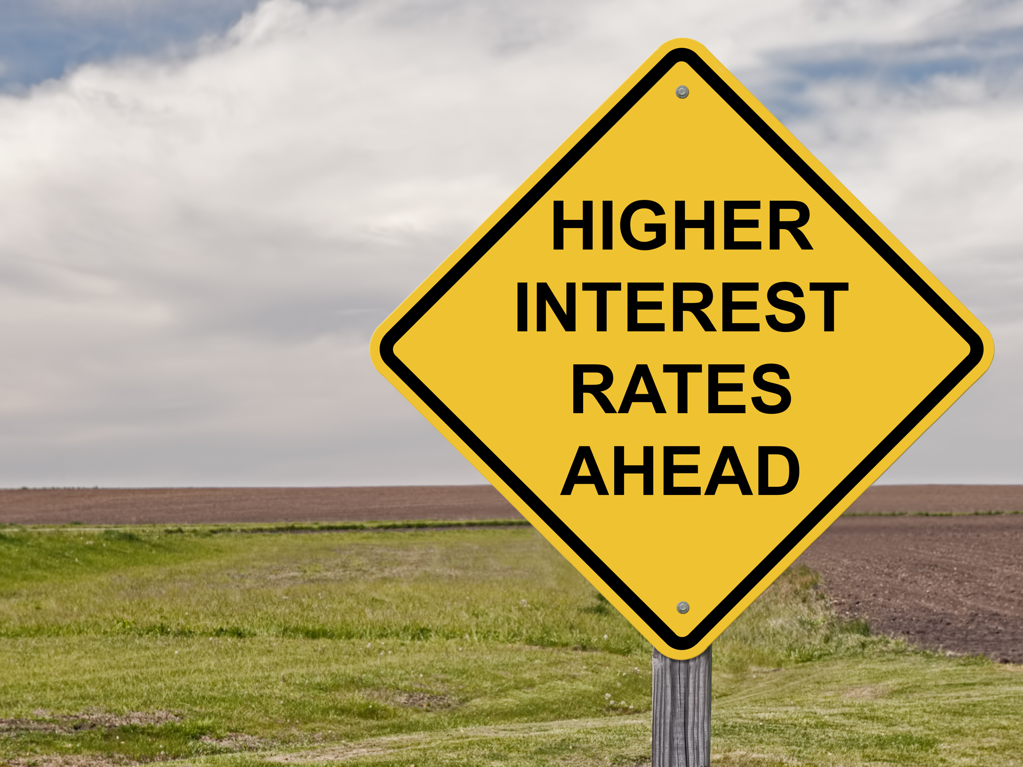 "Road sign saying ""higher interest rates ahead"""