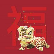 """Traditional lion dance in front of """"luck"""" symbol"""