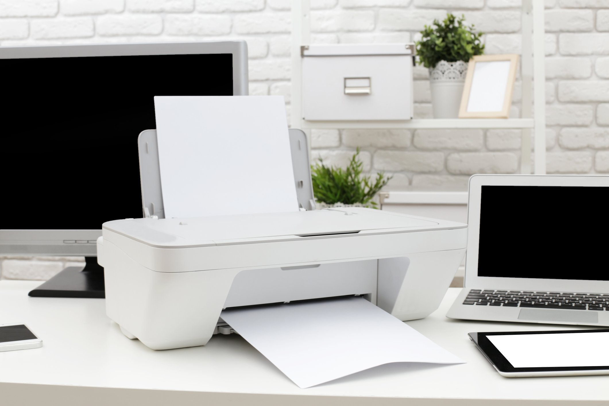 Printer and PC on a desk