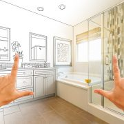 Person visualising renovations by framing their hands