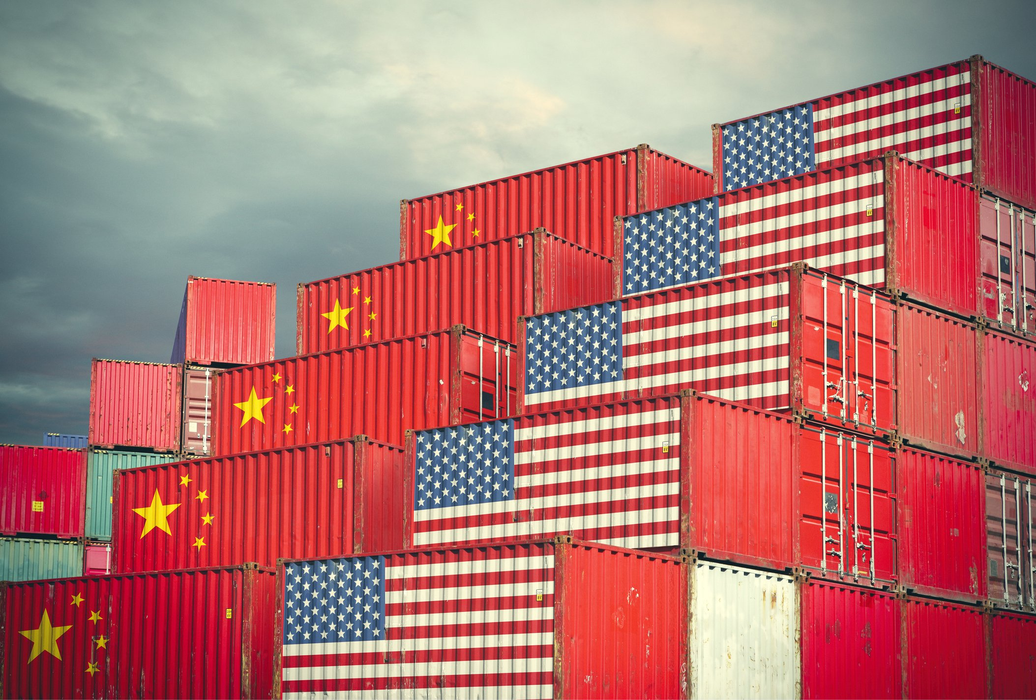 Cargo containers marked wth US and China flags, stacked side by side