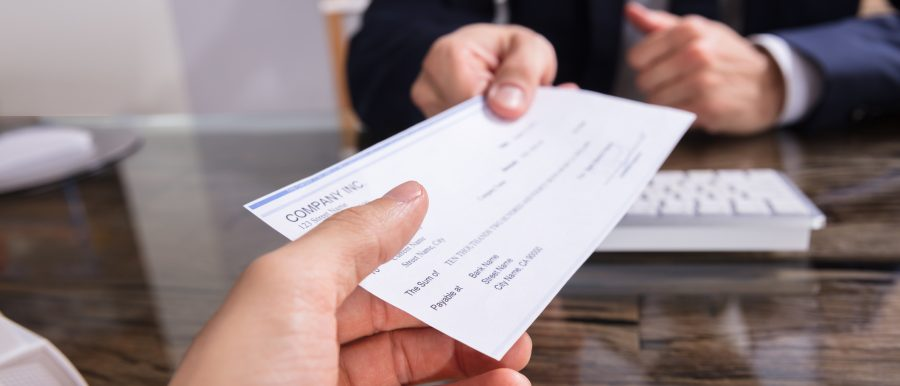 A person haning a cheque to a property agent