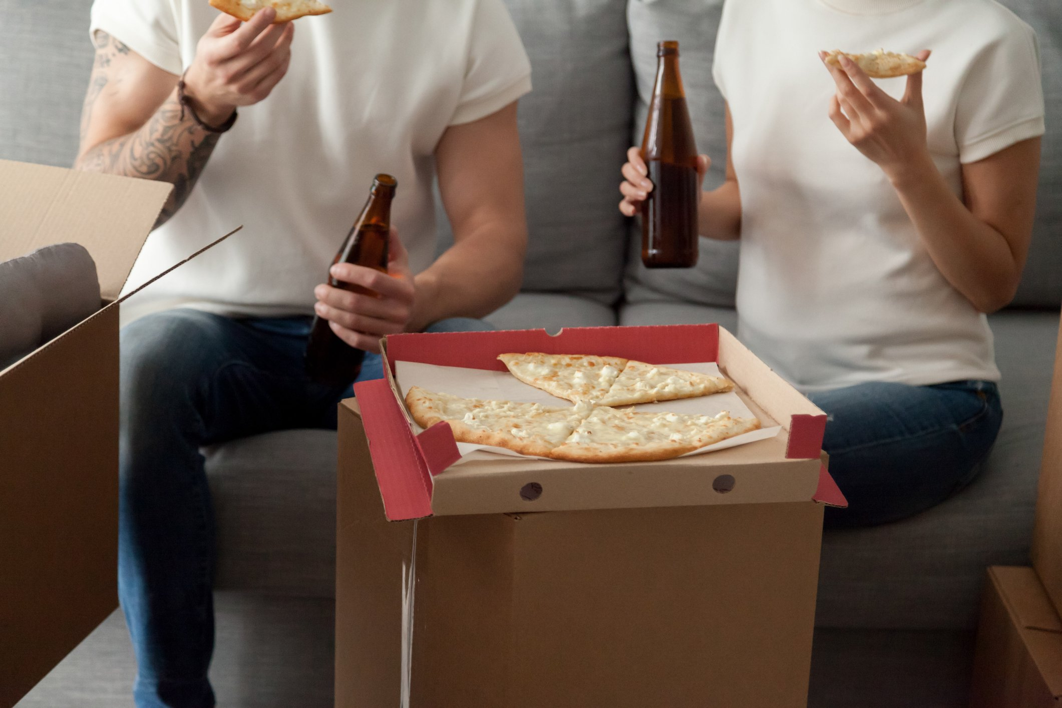 Student tenants eating pizza on a box