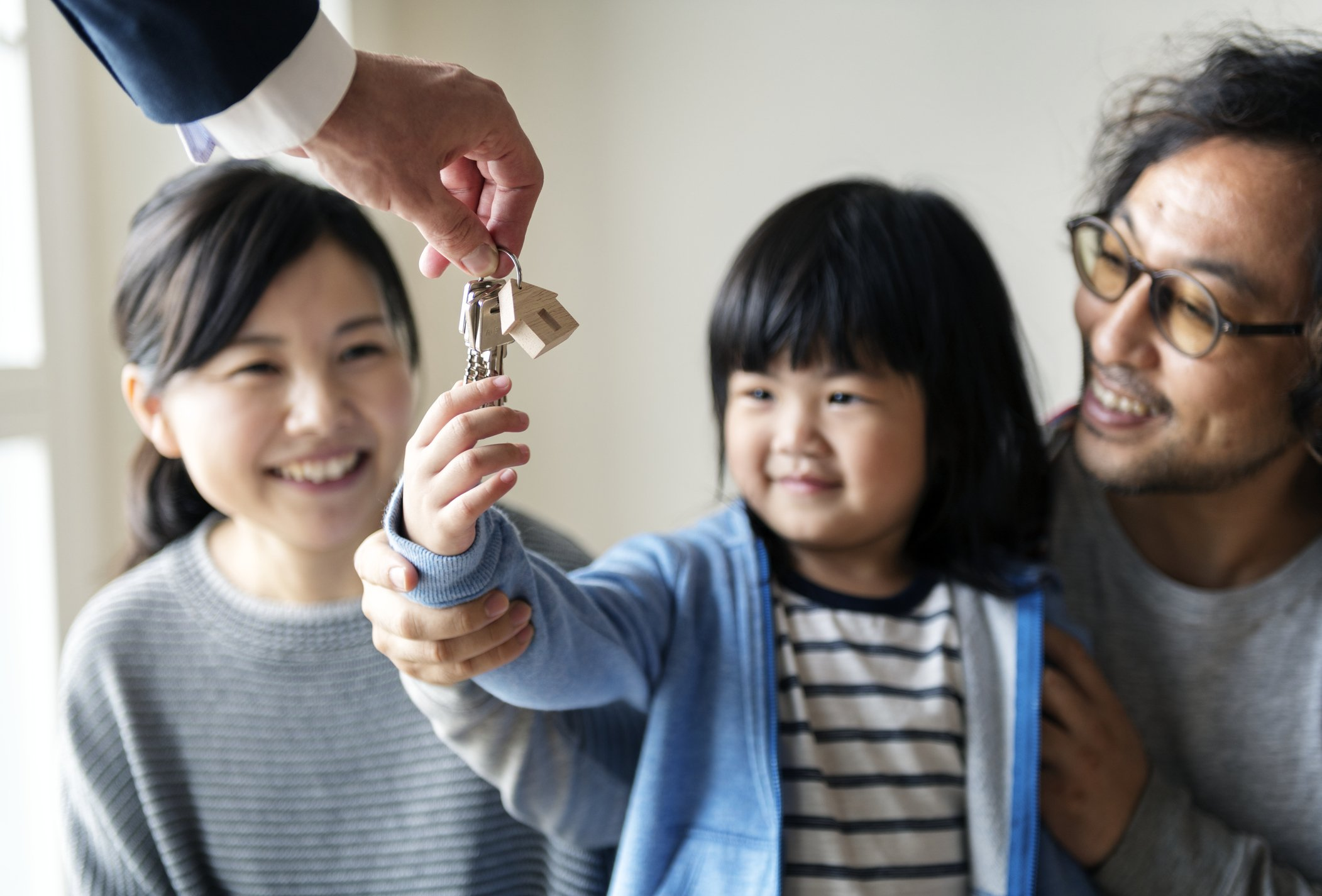 House keys handed to a child