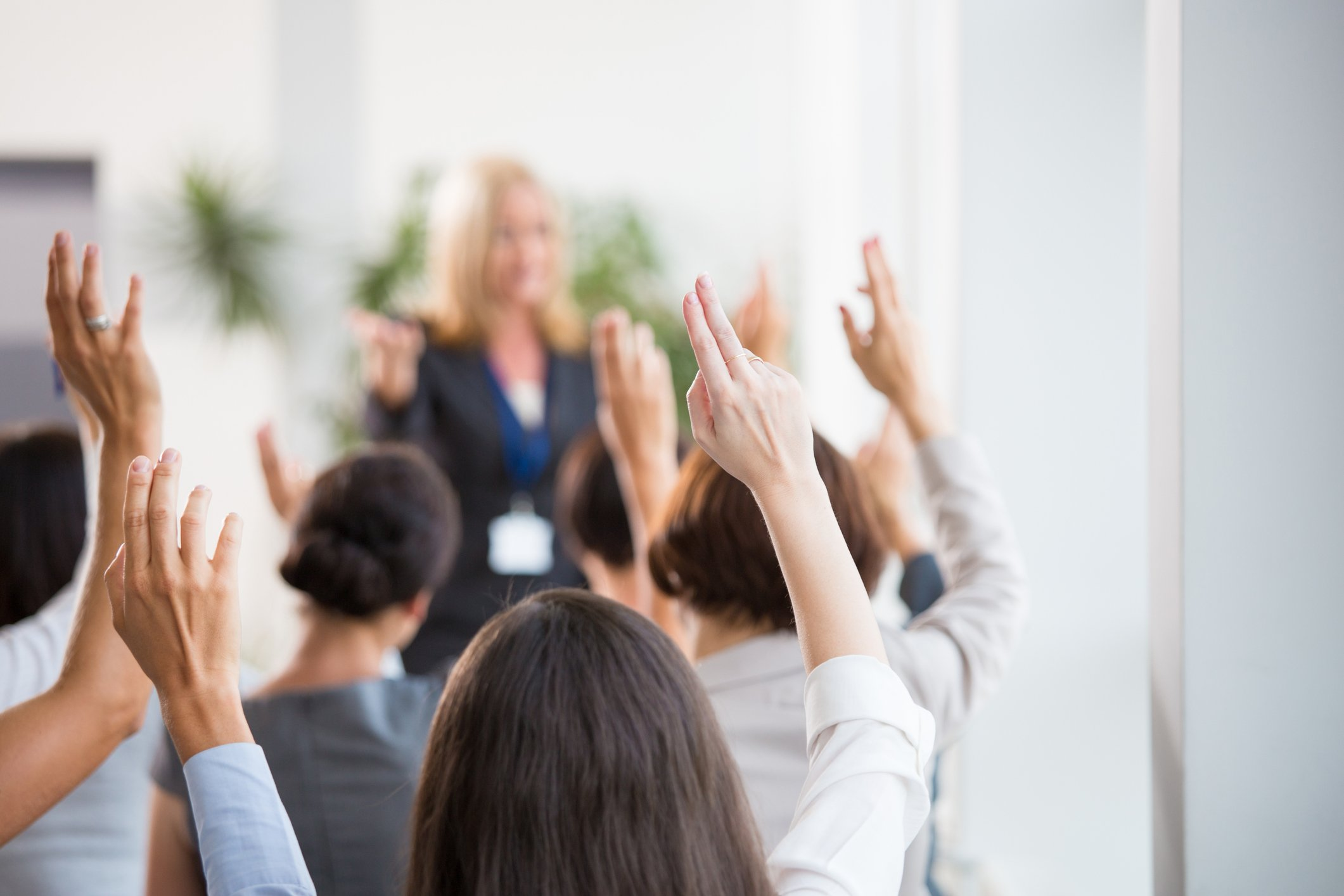 Group of people raising hands