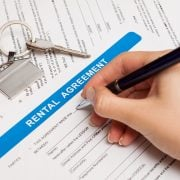 Person signing Rental Agreement form