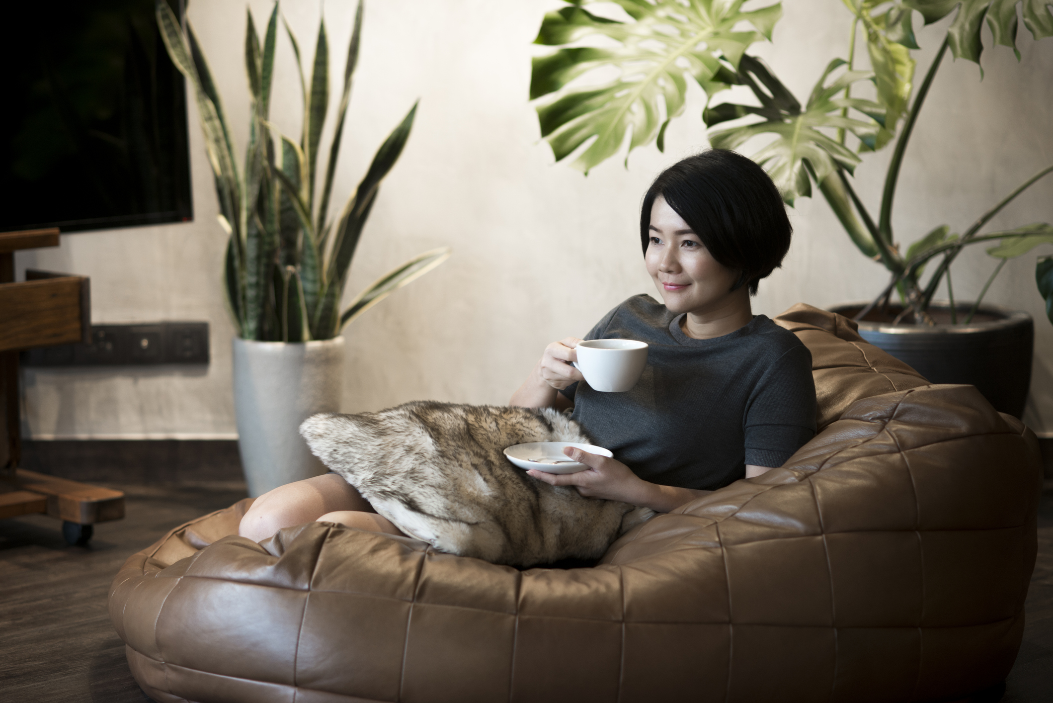 Young woman drinking herbal medicine at home