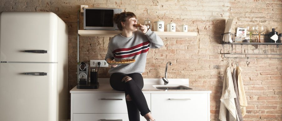 Happy student in her rented apartment