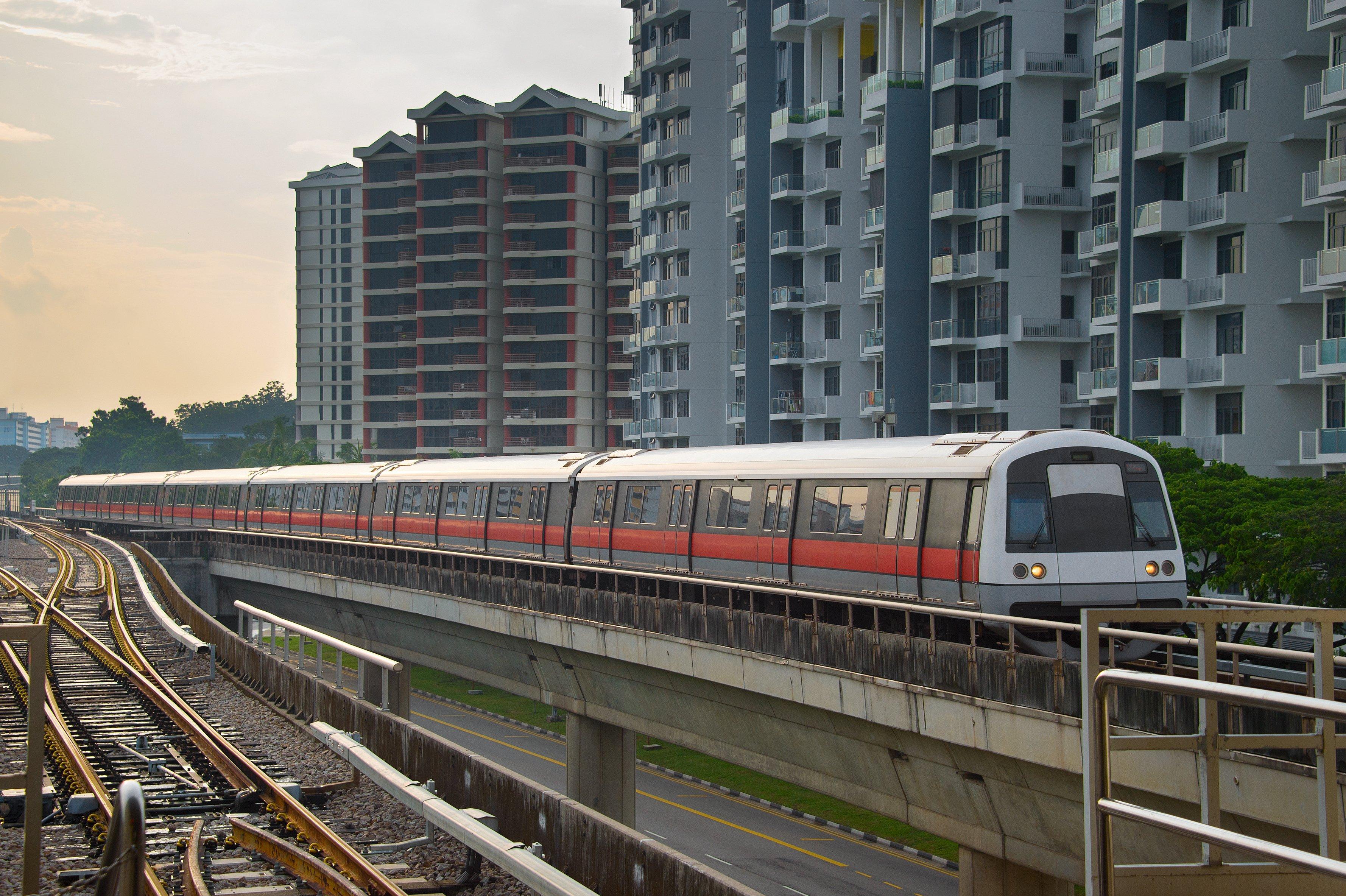 MRT train beside flats