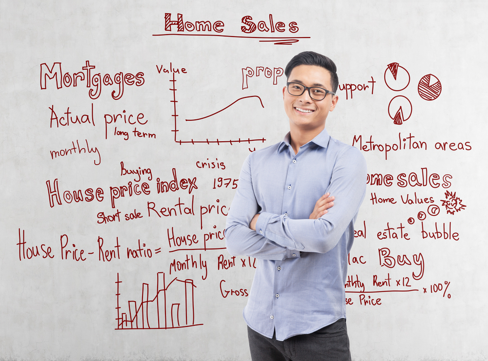 Man in front of board with complex property terms