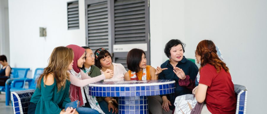 multi-ethnic singaporeans sitting