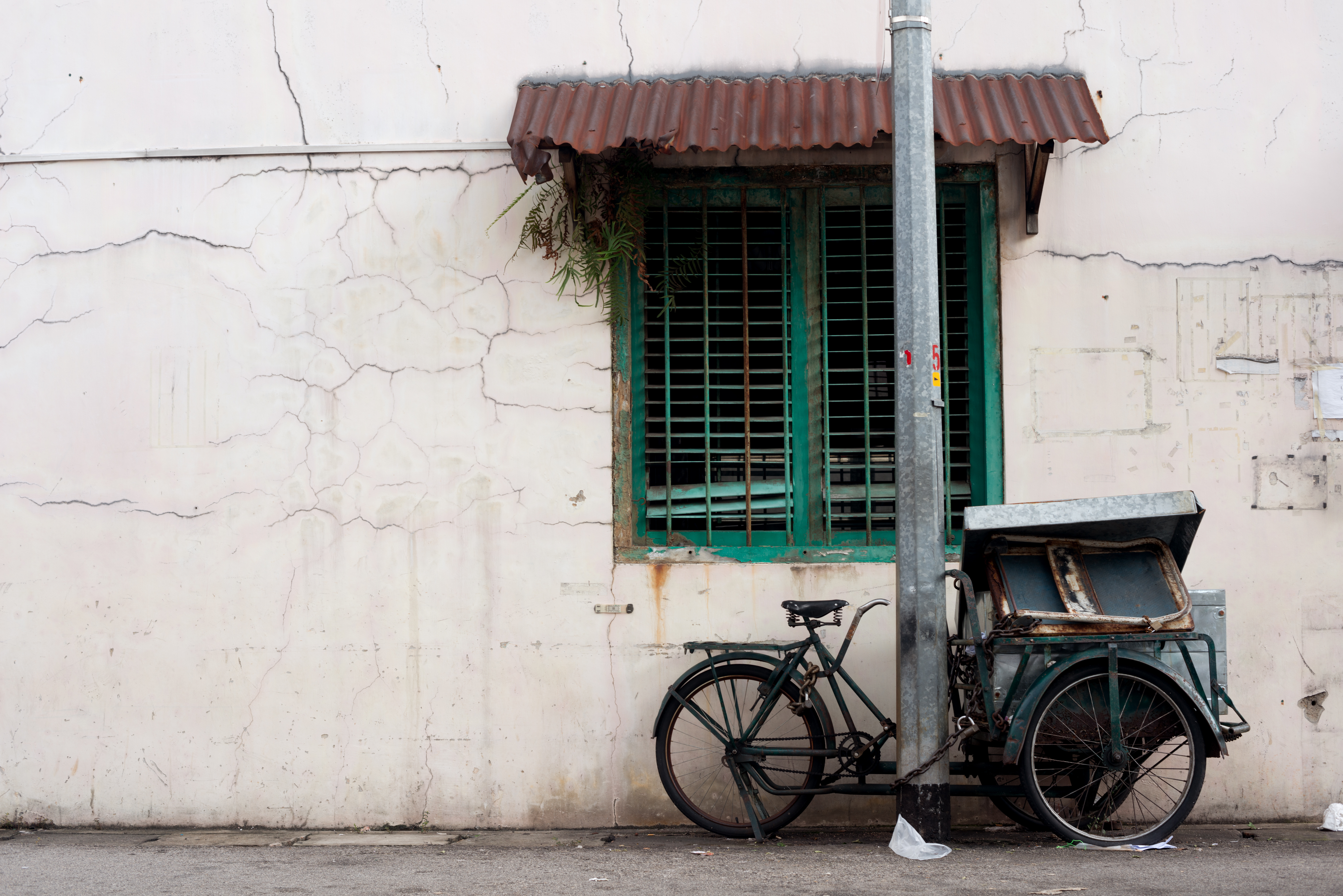 Old singaporean building with bike outside