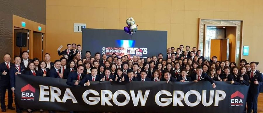 Roy Chong with ERA Grow Group banner and Affluent