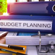 A stack of folders for budget planning
