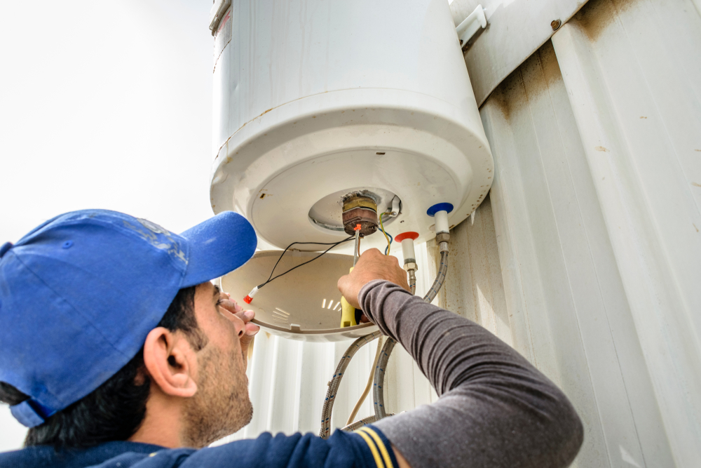 electrician-repairing-water-heater