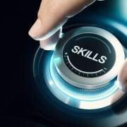 man turning a skills dial