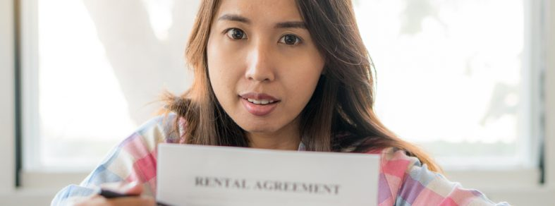 woman holding rental agreement paper