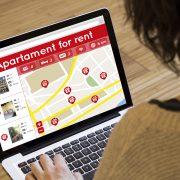 Woman Looking at Home Rental Listings