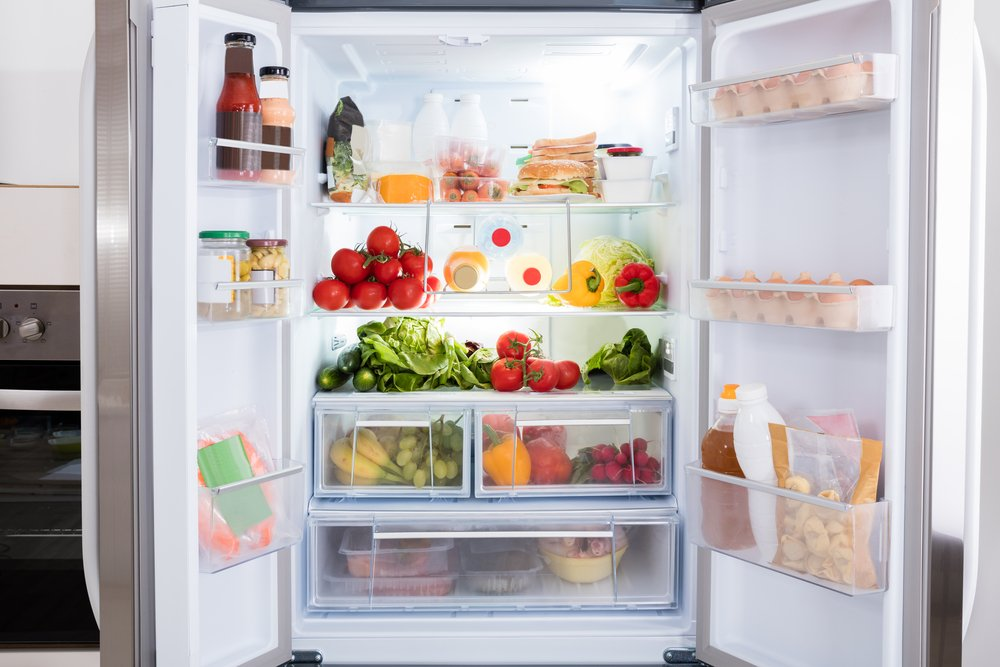 A refrigerator full of food and drinks.