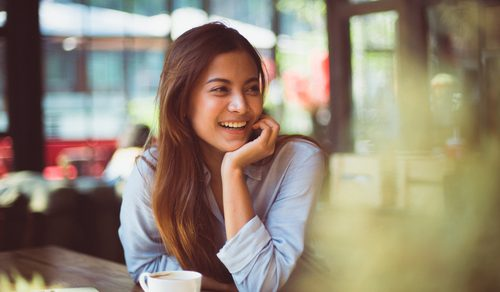 lady at a coffee shop smiling