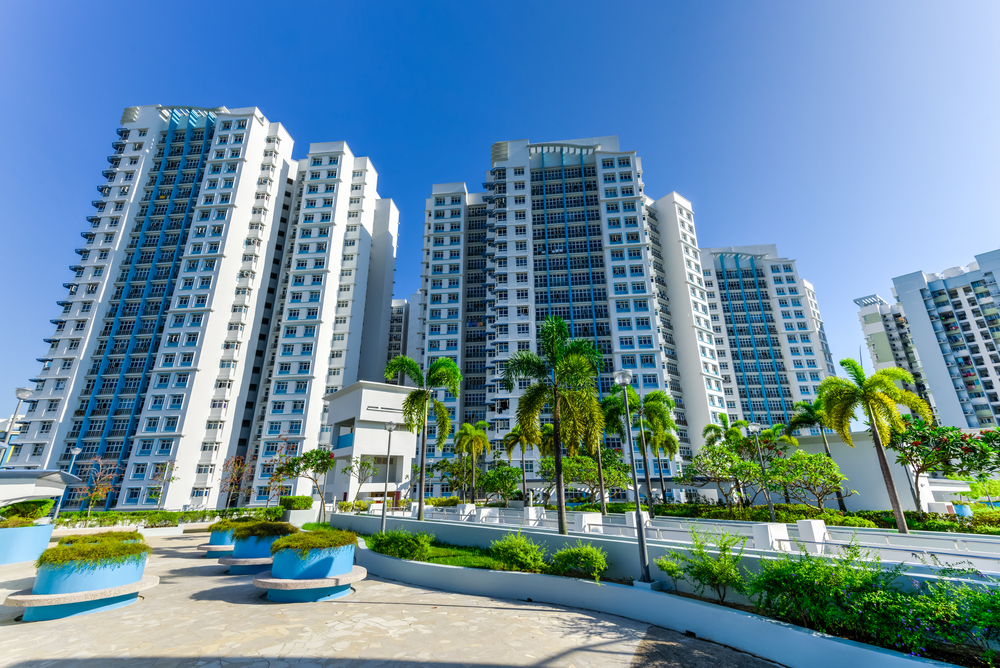 view of a condo from the swimming pool level