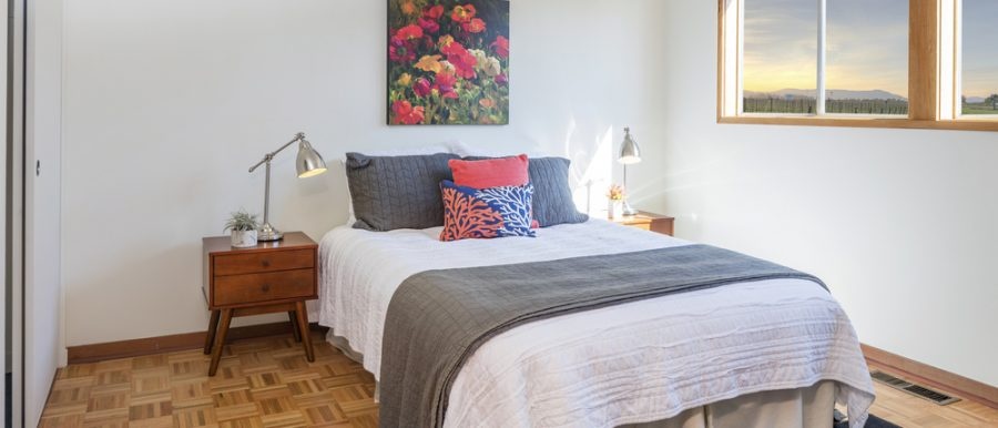 fully furnished bedroom with windom