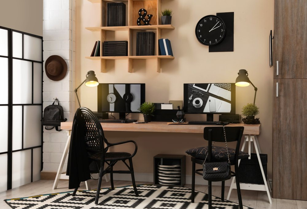 home office with a desk, shelves and computer