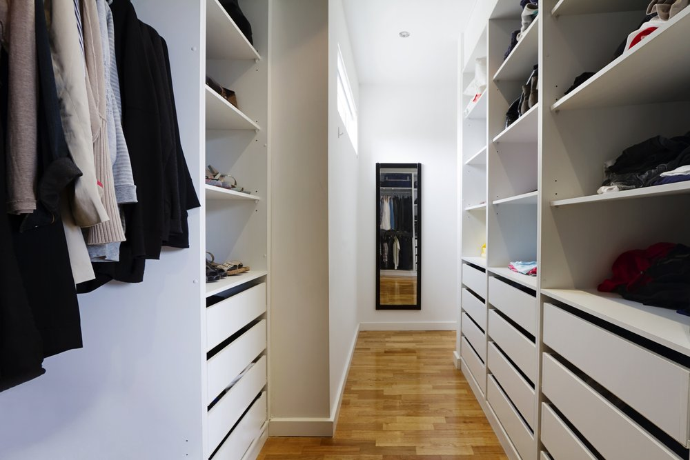 walk in wardrobe with mirror and shelves